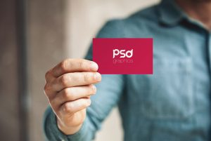 man-holding-business-card-mockup-psd-preview