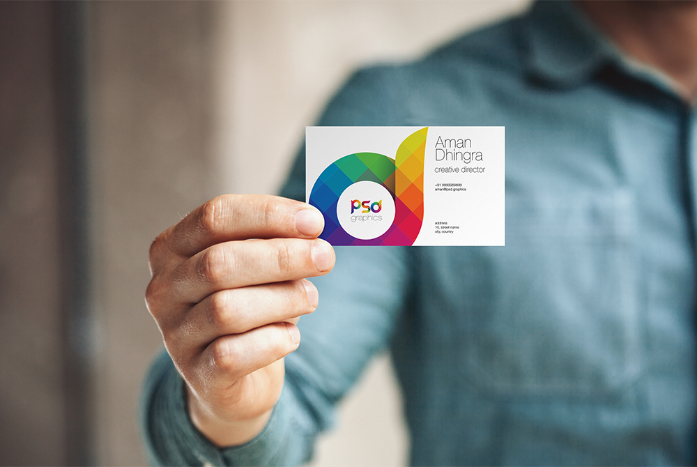Man Holding Business Card Mockup PSD