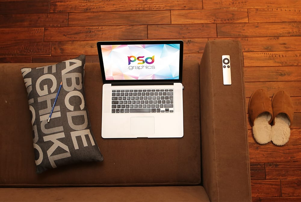Macbook Pro on Sofa Mockup Free PSD
