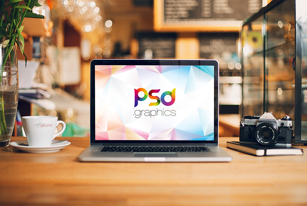 Macbook Pro on Desk Mockup PSD