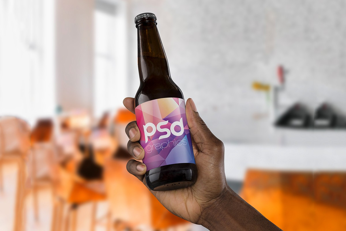 Beer Bottle in Hand Mockup
