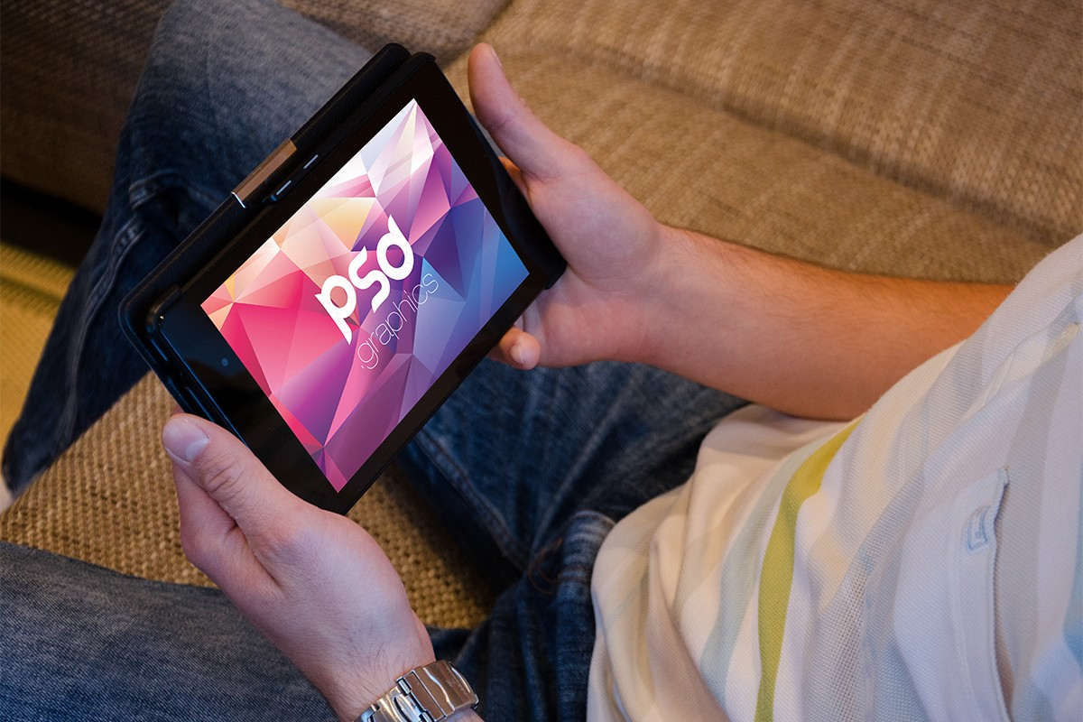 Man Holding Tablet Mockup PSD