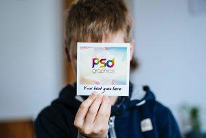 Holding Polaroid Photo Mockup PSD