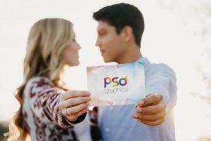 Couple Holding Invitation Card Mockup