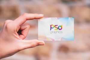 Holding Business Card Mockup PSD Template