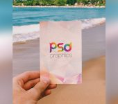 Holding Post Card in Hand Mockup PSD